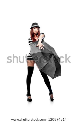 young thoughtful stylish casual caucasian brunette woman in hat and black and white short dress. isolated on white