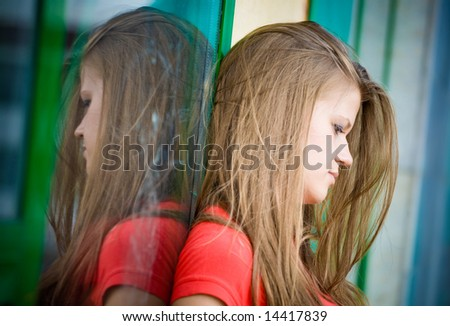Young thoughtful woman near the window. - stock photo