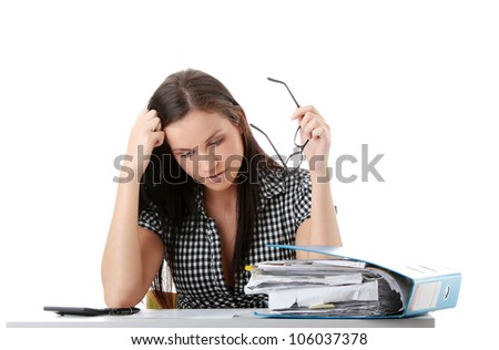 Young tired woman holding in hand black glasses sitting at the desk with folder and calculator working, learning. Isolated on the white background.