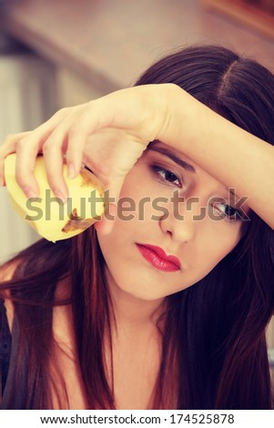 Young tired woman peeling potato - stock photo