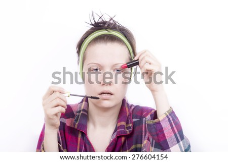 Young tired woman with her make-up - stock photo