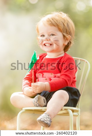 Young toddler playing outside - stock photo
