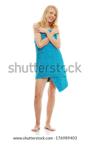 Young topless caucasian woman with blue towel isolated on white background