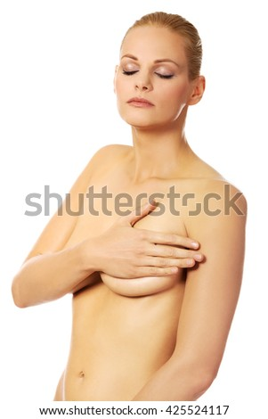 Young topless woman covering her breast