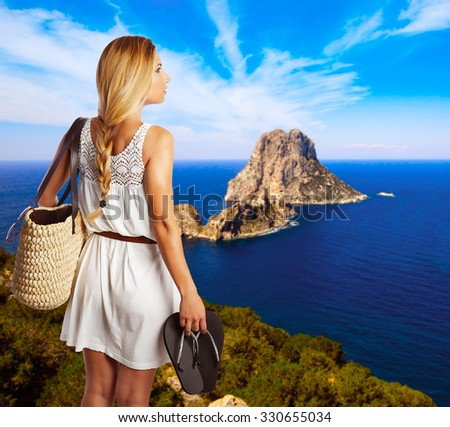 young tourist girl in formentera with es vedra