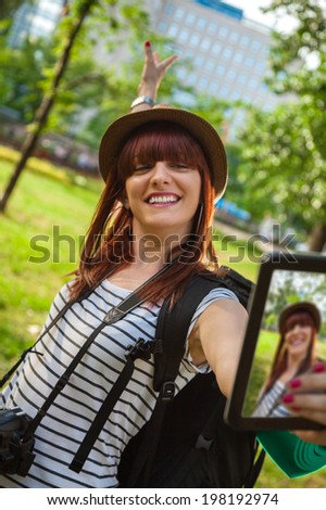 Young Tourist Girl Taking Selfie Using Digital Tablet - stock photo