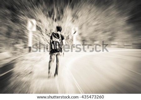 Young tourist man walking on the road,Man hitchhiking,Man  travel,Journey,Alone,Blurry portrait,Blurry portrait,Motion blur,Black and white - stock photo