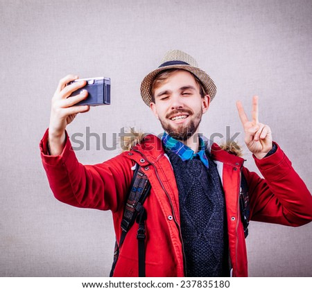 Young tourist taking a picture with camera - stock photo