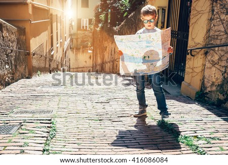 Young tourist with city map stay on the old italian street - stock photo