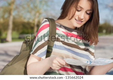 Young tourist   woman  with a map - stock photo