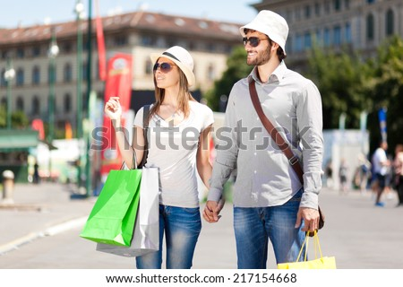 Young tourists shopping in a city - stock photo
