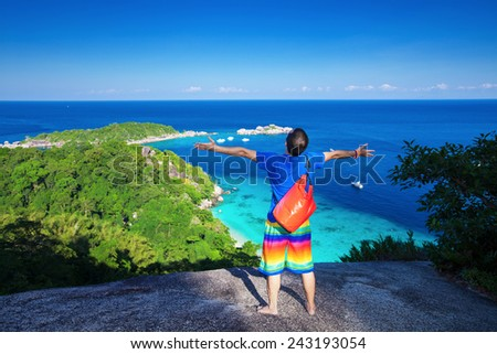 Young traveler enjoy at the view point over the sea bay - stock photo