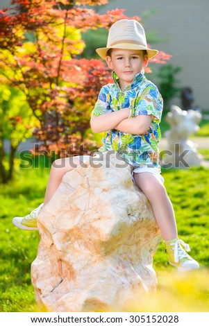 Young traveler in hat over garden background - stock photo