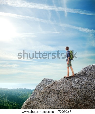 Young traveler looking tropical landscape - stock photo