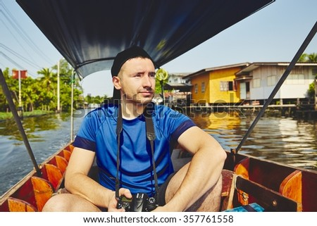 Young traveler on the boat in Bangkok, Thailand - stock photo