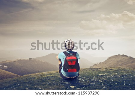 Young traveler watching a landscape - stock photo