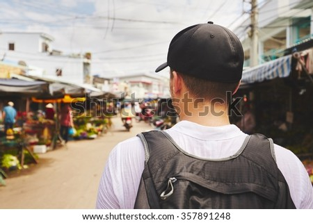 Young traveler with back pack - Phu Quoc, Vietnam  - stock photo