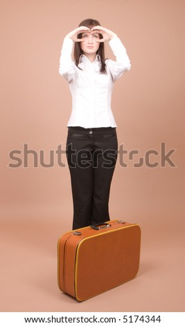 Young traveler with suitcase isolated on beige background - stock photo