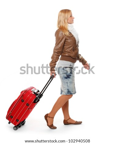 Young traveler woman on a white background.