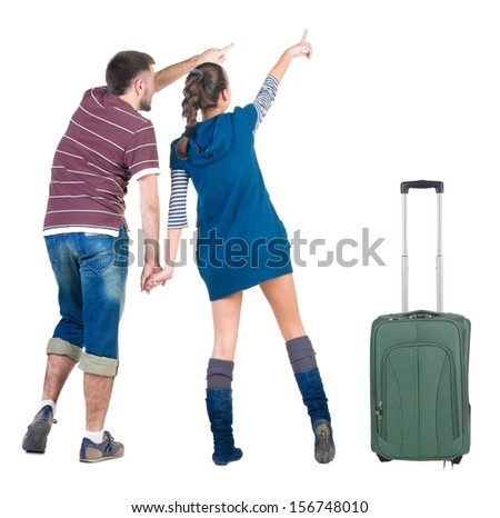 Young traveling couple with suitcas looks where that. Back view people. Isolated over white. - stock photo