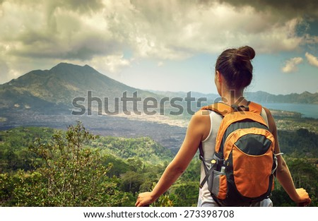 Young traveling woman with backpack. focus on backpack, happy female walking in the island to Bali, discovering world, summer vacation concept - stock photo