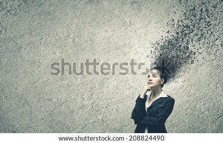 Young troubled businesswoman thinking over the ideas - stock photo