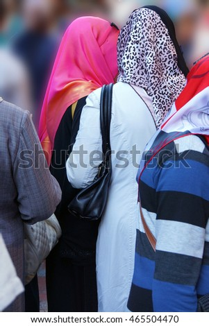 Young Turkish women with scarves move through the crowded streetsnear the Grand Bazaar, in Istanbul Turkey