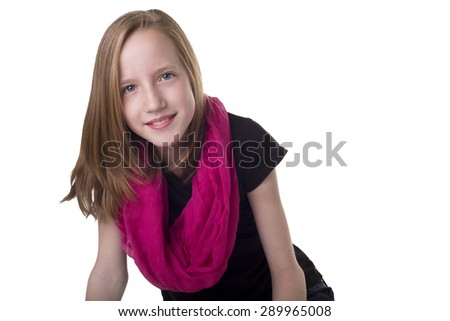 Young tween girl smiling isolated on white