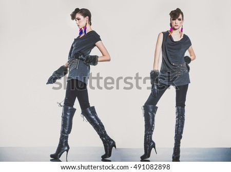 young two woman Girl in jeans. Girl with gloves, boots ,posing in studio