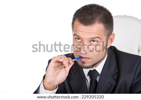 Young unemployed man is writing summary. He is looking for a job. - stock photo