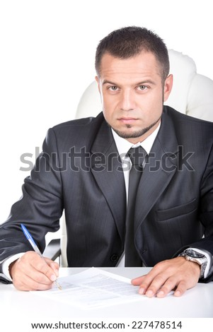 Young unemployed man is writing summary. He is looking for a job. Looking at the camera. - stock photo