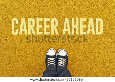 Young unemployed man standing on street pavement in front of Career Ahead sign printed.  - stock photo
