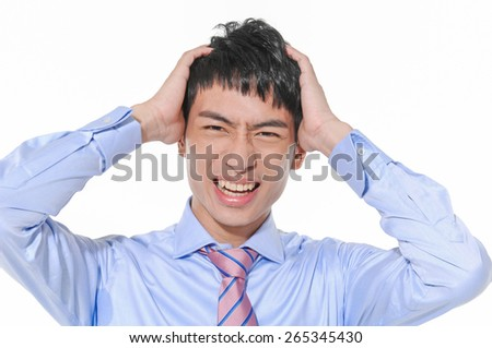 young unhappy businessman holds his head, stress,  - stock photo