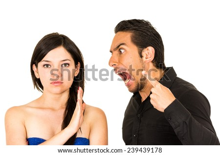 young unhappy woman not listening to angry screaming husband boyfriend isolated on white - stock photo