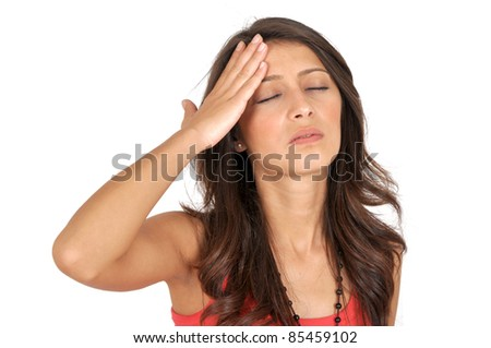 Young unhappy woman with severe headache holding forehead in pain - stock photo
