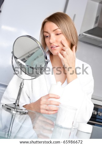 young upset woman has problems with her skin - stock photo