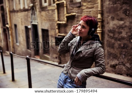 Young urban girl listening to music - stock photo