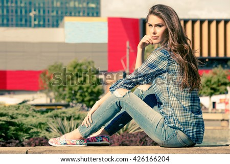 young urban woman in casual clothes  in the city - stock photo