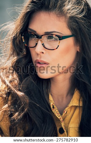 young urban woman with eyeglasses portrait, outdoor, close up - stock photo