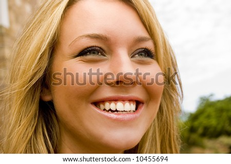 Young vibrant girl laughing