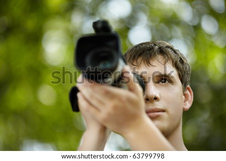 young videographer - stock photo