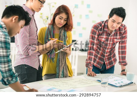 Young Vietnamese business team working in the office