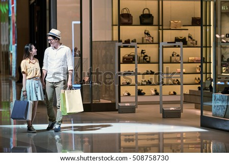 Young Vietnamese couple shopping in mall together