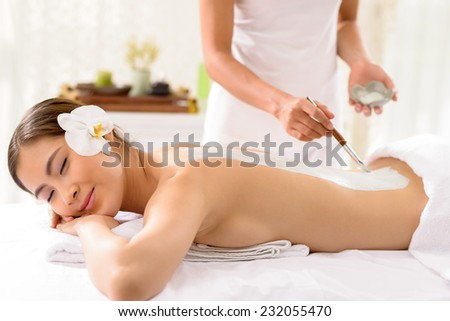 Young Vietnamese woman enjoying beauty treatment at the spa salon