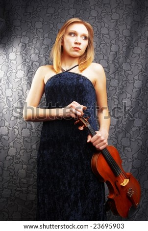 Young violinist with her violin - stock photo