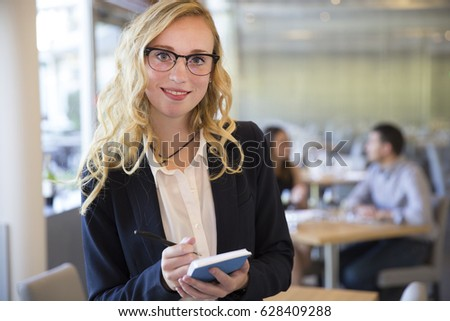 Young waitress woman in a restaurant