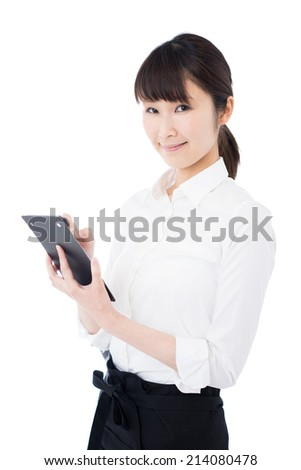 young waitress writing an order, isolated on white background
