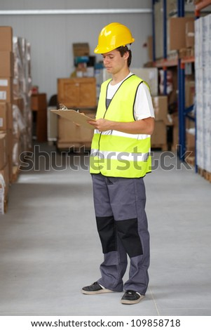Young warehouse worker do some stock stock photo 109858748 young warehouse worker do some stock check sciox Choice Image