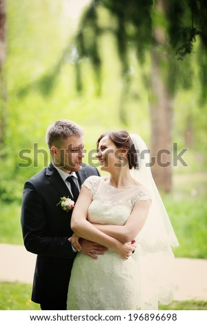 young wedding couple, beautiful bride with groom portrait - stock photo