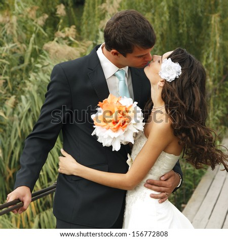 young wedding couple, beautiful bride with groom, summer nature outdoor